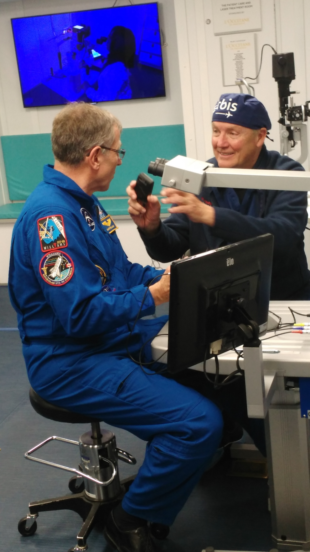 Retired Canadian astronaut Dave Williams (left) and Orbis volunteer Brian Leonard, a Canadian doctor, discuss a simulated eye surgery during a livestream June 2, 2019