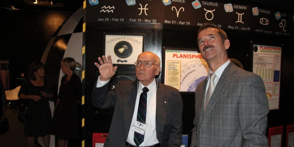 Bruce Aikenhead gives astronaut Chris Hadfield a tour of the Okanagan Science Centre space galleries he curated after he retired. Credit: Okanagan Science Centre.
